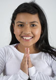 Indian Girl giving the traditional welcome sign. Stock Photography