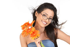 Indian girl with glasses holding daisy flowers Stock Image