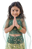 Indian girl greeting Stock Image
