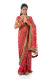 Indian girl in a greeting pose. Traditional sari costume, full length standing isolated on white background Stock Images