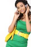 Indian girl with headphone Stock Image