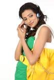 Indian girl with headphone and handbag Stock Photo