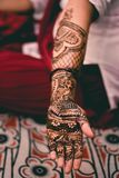 Indian Girl Henna Art Work. Indian girl with henna artwork done on one hand shows off the beauty of the art work done during festive season on her hand royalty free stock photos