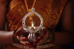 Indian Girl Holding kamatshi Amman Oil Lamp. With flame Royalty Free Stock Images