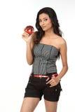 Indian girl holding pomegranate Stock Image