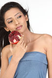 Indian girl holding pomegranate Stock Images