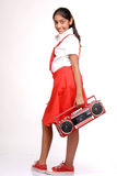 Indian girl holding tape recorder Royalty Free Stock Image