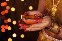 Indian Girl Holding Traditional Oil Lamp Stock Photography
