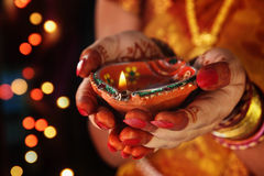 Indian Girl Holding Traditional Oil Lamp Royalty Free Stock Photo