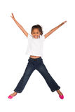 Indian girl jumping. A happy young indian girl jumping on white background Stock Photo