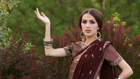 Indian girl with kundan jewellery and mehendi. stock footage