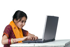 Indian girl and laptop computer. Isolated on white Royalty Free Stock Image