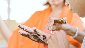 Indian Girl Master Applies Henna Tattoo on Palm stock video footage