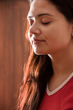 Indian  Girl in meditation. A beautiful Young Indian girl in red dress doing meditation Royalty Free Stock Photos