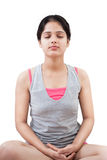 Indian girl in meditation. Beautiful Young Indian girl in pink gray dress  doing meditation with closed eyes Royalty Free Stock Images