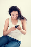 Indian girl with mobile smart phone 2 Stock Photos