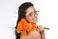 indian girl with orange daisy flowers Royalty Free Stock Photography
