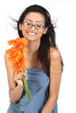 Indian girl with orange daisy flowers Stock Photography