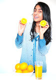 Indian girl with oranges. Indian pretty girl with oranges at home Royalty Free Stock Image
