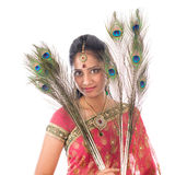 Indian girl with peacock feathers Royalty Free Stock Images