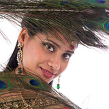 Indian girl with peacock feathers. Stock Image