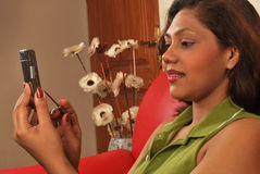 Indian girl on phone. Young indian girl using touch screen  mobile phone Stock Photography