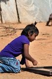Indian girl playing on the street in Bangalore Royalty Free Stock Photo