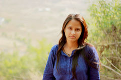 Indian girl portrait with natural blurred background Stock Photos