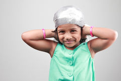 Indian girl poses with hands on her ears Stock Photo