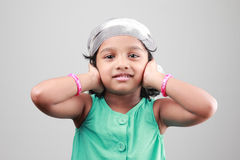 Indian girl poses with hands on her ears Royalty Free Stock Photo