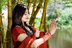Indian girl praying Stock Photo