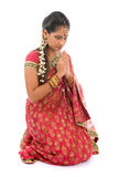 Indian girl in a praying position Stock Images