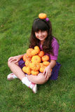 Indian girl with pumpkins Royalty Free Stock Photography