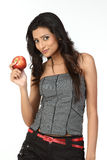 Indian  girl with red apple Stock Image