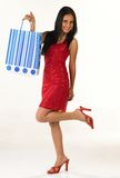 Indian girl with red skirt. Lifting her one leg up Stock Image