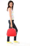 Indian  girl with red suitcase Stock Images