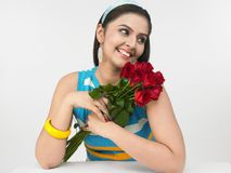 Indian girl with roses Stock Photography
