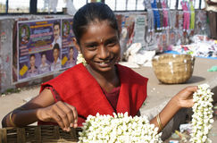 Indian girl selling flowers Royalty Free Stock Image