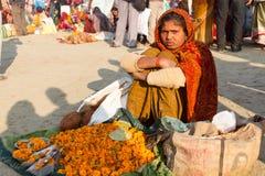 Indian girl selling flowers at the Kumbha Mela, india. Stock Image