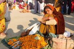 Indian girl selling flowers at the Kumbha Mela, india. Stock Photo