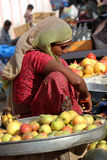 Indian girl selling fruit on the street Royalty Free Stock Photo
