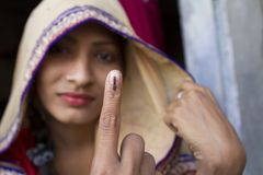 Election Symbol. Indian girl showing election symbol on her finger after voted Royalty Free Stock Photo