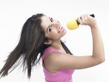 Indian girl singing Stock Photos