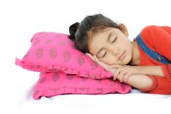 Indian Girl sleeping over pillow. stock photography