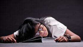 Indian girl sleeping tired of studying Royalty Free Stock Photography