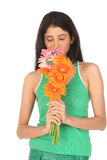 Indian girl smelling the daisy flowers Stock Photo