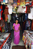 Indian girl standing in her shop Stock Photos