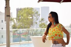 Indian girl with tattoo on stomach looking out, Pune. Maharashtra royalty free stock photography
