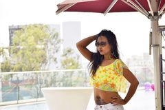 Indian girl with tattoo on stomach looking out, Pune. Maharashtra stock photos