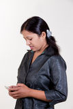 Indian girl texting over mobile Royalty Free Stock Photography